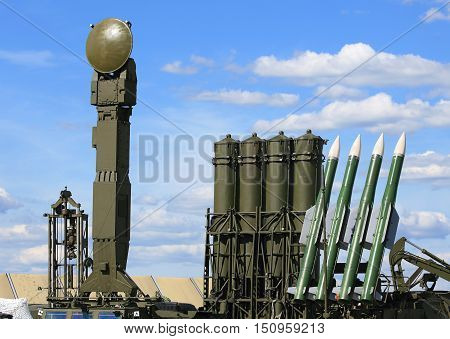 Containers with missiles and radar antenna of the air defense system