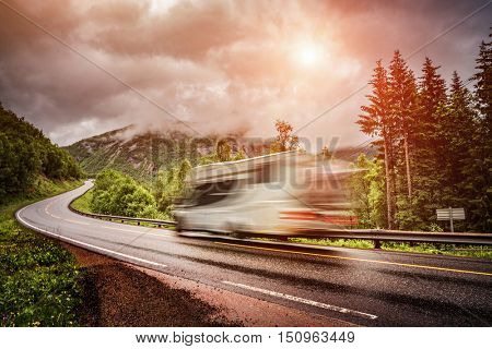 Caravan car travels on the highway. Caravan Car in motion blur. Filter applied in post-production.