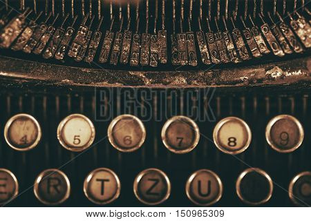 Vintage Typewriter Types Closeup Photo. Vintage Writing Equipment. Dark Sepia Color Grading