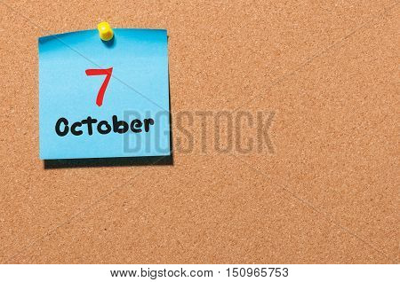 October 7th. Day 7 of month, color sticker calendar on notice board. Autumn time. Empty space for text.