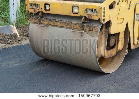 Road paving / Road roller compacting asphalt