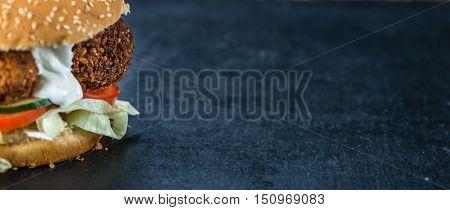 Falafel Burger On A Slate Slab