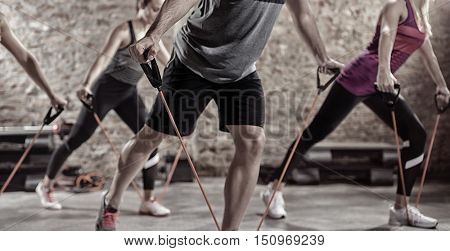 Group of sporty people,  exercising with stretching band