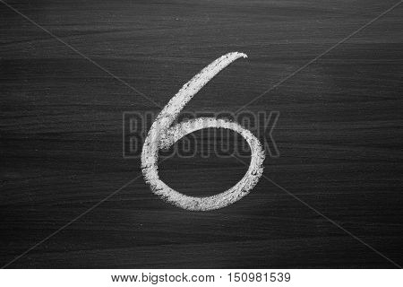 number six enumeration written with a chalk on the blackboard
