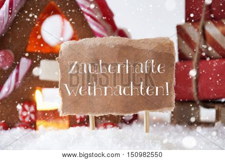 Gingerbread House In Snowy Scenery As Christmas Decoration. Sleigh With Christmas Gifts Or Presents And Snowflakes. Label With German Text Zauberhafte Weihnachten Means Magic Christmas