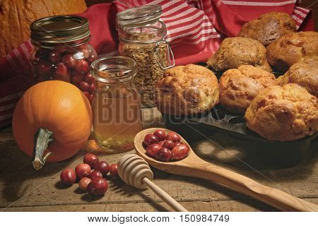 Fresh muffins with fresh cranberries on table