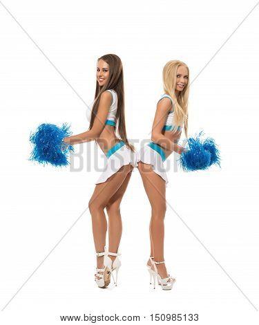 Cheerleading. Smiling lovely girls posing with pom poms