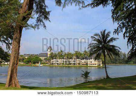 Laguna Beach ResortPHUKET THAILAND - NOV 06 2016: Luxury villa with lagoon lake and palm around