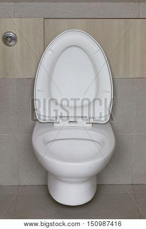 Modern Toilet bowl in a men bathroomwhite ceramic flush toilet for men in toilet room.