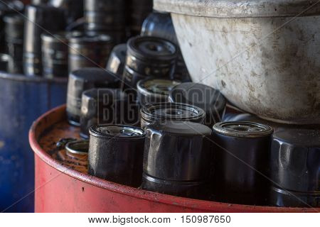 Picture of old and used engine air filters in automotive maintenance service. Closeup picture of old oil filters for automobile.