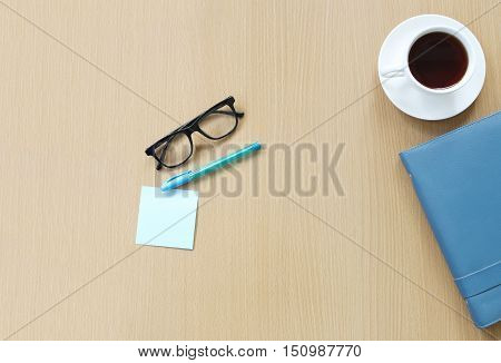 Equipment on desk in a office and copy space for input ideas and business concepts on brown wooden background.