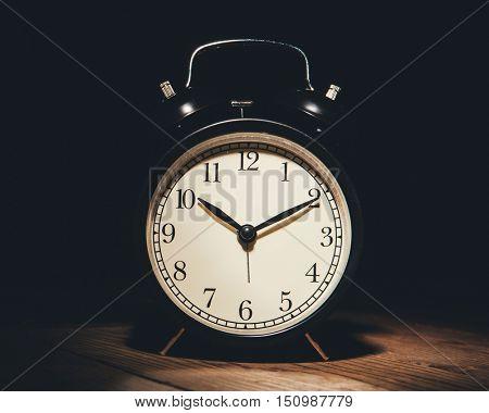 alarm clock in the darkness, black background