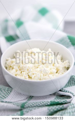 Organic Cottage Cheese In A White Ceramic Bowl On The Kitchen Table. Dairy Products For The Healthy