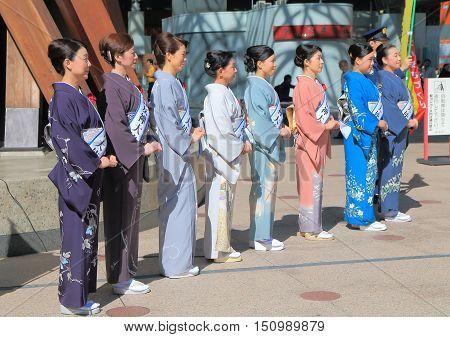 KANAZAWA JAPAN - OCTOBER 7, 2016: Unidentified kimono models welcome tourists at Kanazawa Station.