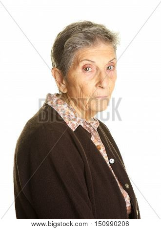 Senior woman in her eighties with blank, sad expression.  Shot on a white background in the studio