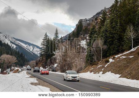 Road And Snow Covered Tuscarora Peaks Near Brighton. Utah Usa