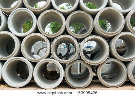 Concrete drainage pipes stacked on construction site