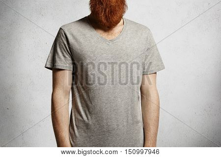T-shirt Design And Advertising Concept. Cropped Studio Portrait Of Young Caucasian Male Posing Again