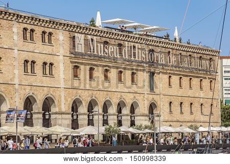 BARCELONA SPAIN - JULY 4 2016: Museum of History (Palau de Mar 1880-1890) in front of the harbor.