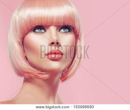 Beauty Fashion Model Portrait pink hair color. Bob Short Haircut. Fringe Hairstyle. Hairdressing. Beautiful Glamour Girl with Short blonde hair. Dyed hair, perfect makeup poster