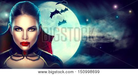 Halloween Background, Vampire Woman portrait. Beauty Sexy Vampire Girl with dripping blood on her mouth. Vampire makeup Fashion Art design. Attractive model girl in Halloween costume and make up