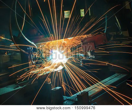 semi auto welding in manufacturing plant automotive part.