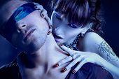 woman vampire bites a blind man poster