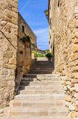 Medieval streets in the village of Pals in Catalonia Spain poster