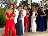 Group of Teenagers At the Prom - They are lined up in a row posing with happy smiles poster