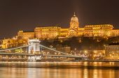 Night view of the Szechenyi Chain Bridge over Danube River and Royal Palace in Buda Castle in Budapest Hungary poster
