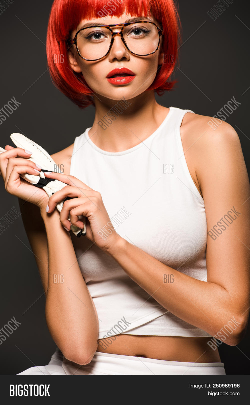 866071e629 Beautiful Young Woman With Red Bob Cut In Golf Glove And Stylish Eyeglasses  Looking At Camera