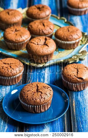 Chocolate Lava Muffins On A Blue Wooden Board