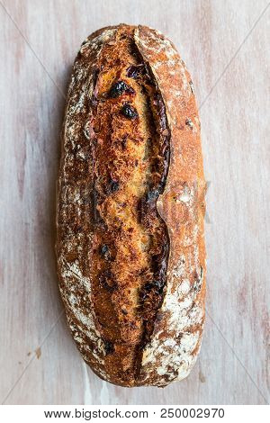 Cranberry And Hazelnut Sourdough Bread On A Wooden Table Board
