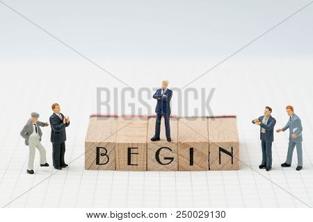 Begin, Company Establish Or Start Own Business Concept, Miniature Figure Businessman Standing On Woo