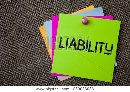 Handwriting Text Writing Liability. Concept Meaning State Of Being Legally Responsible For Something