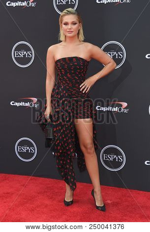 LOS ANGELES - JUL 18:  Olivia Holt arrives to the 2018 ESPY Awards  on July 18, 2018 in Hollywood, CA
