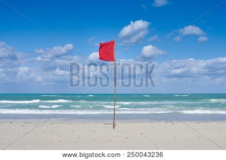 A Warning Red Flag On The Coast, Hung Out At High Waves, Strong Wind, Storm And Other Dangers, Swimm