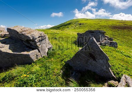 Huge Rocky Formation On Hillside. Lovely Summer Scene In Mountains. Beautiful Nature Background Of A