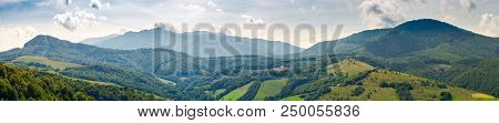 Panorama Of Beautiful Carpathian Mountains. Perfect Countryside Landscape. Rural Field On The Neares