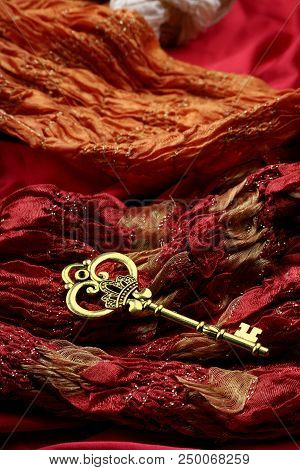 Antique Golden Key On Red Luxury Fabric