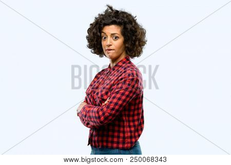 Beautiful arab woman nervous and scared biting lips looking camera with impatient expression, pensive