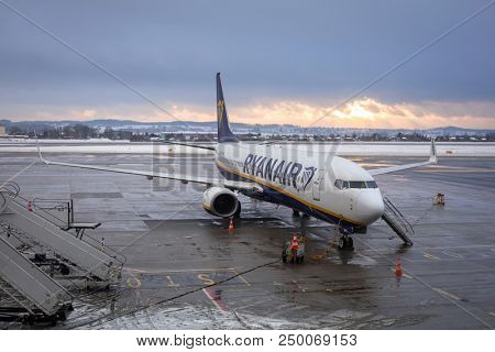 Gdansk, Poland - January 19, 2018: Preparing for boarding to Ryanair plane on Lech Walesa Airport in Gdansk. Ryanair operates over 300 aircraft and is the biggest low-cost airline company in Europe