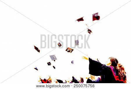 Graduate Students Throwing Mortarboards In The Air In University Graduation Success Ceremony. Congra