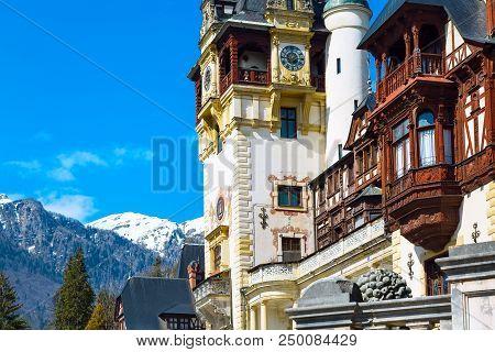 Landscape with Bucegi mountains and romanian landmark, Peles castle in Sinaia, Romania poster