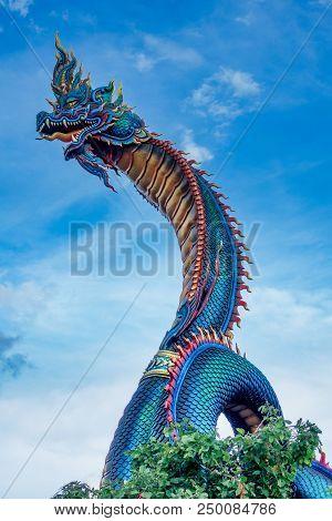 Giant Thai Naga Statue In The Phu Manorom Temple, Mukdahan, Thailand