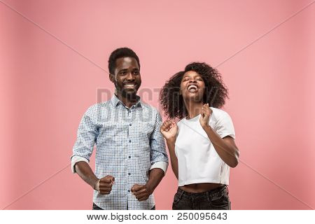 We Won. Winning Success Happy Afro Man And Woman Celebrating Being A Winner. Dynamic Image Of Caucas