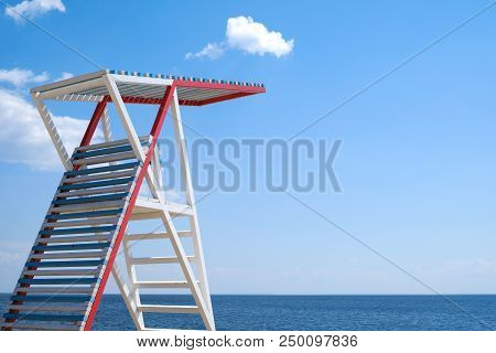 Lifeguard Tower On The Empty Beach Of Sea.