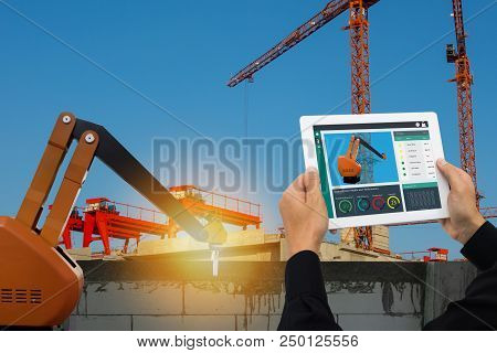 Iot Smart Factory , Industry 4.0 Technology Concept, Engineer Use Tablet To Monitor, Detect And Anal