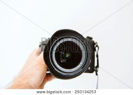 Paris, France - Jun 30, 2018: Man Showing New Panasonic Lumix Dmc-gh5 - And Newest Leica Vario-elmar