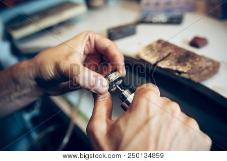 Different Goldsmiths Tools On The Jewelry Workplace. Jeweler At Work In Jewelry. Desktop For Craft J